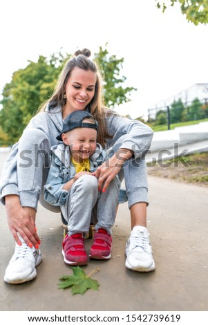 Family mother woman little boy son 3-5 years old, summer city autumn, laughs, laughs fun, emotions joy relaxation weekend, communication and love. Everyday clothes, parenting support care for child #1542739619