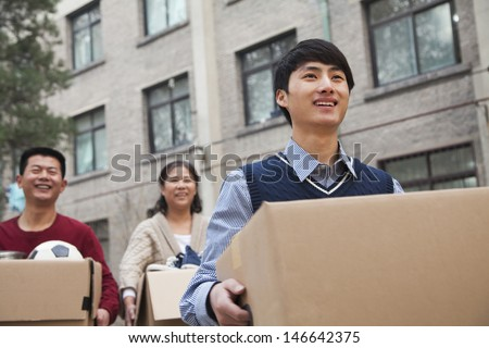 Family moving boxes into a dormitory at college #146642375