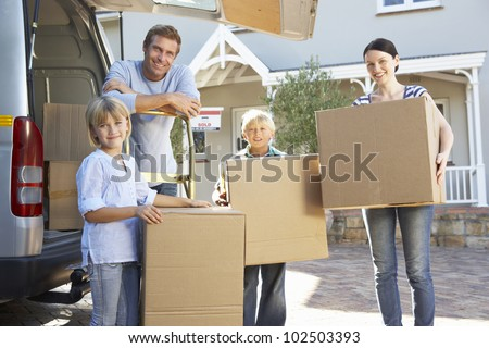 Family moving house - stock photo