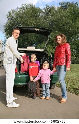 family near car - stock photo