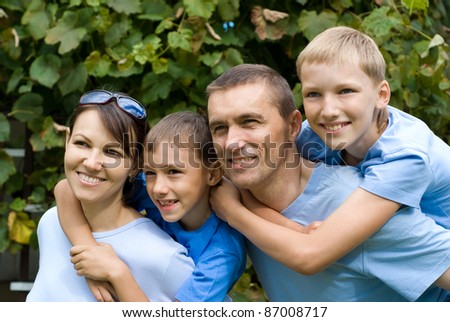 family of a four playing at nature