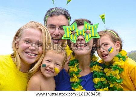 Family of Brazilian soccer fans commemorating victory.