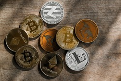 Family of cryptocurrency. Stack of shining golden and silver coins with sunlight on wooden background. Crypto group. Ripple and litecoin dominance, Warm colours - photo of crypto coins.