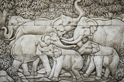 Family of elephants concrete carving on the wall , black and white style