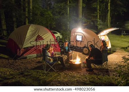 Family of five camping at night with campfire #498023056