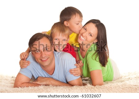 family of four on a light background
