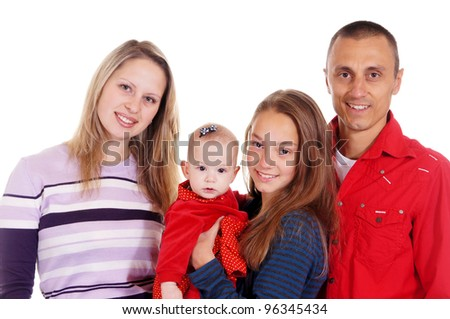 family of four people standing on a light background
