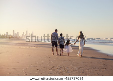 Family of four portrait on the beach, soft selective focus, toning