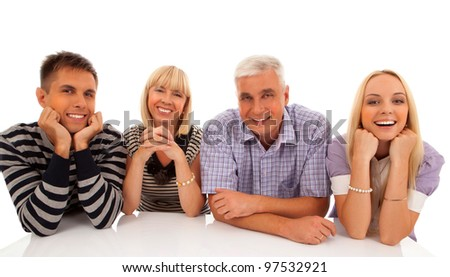 family of four sitting around the white table portrait isolated on white background - stock photo