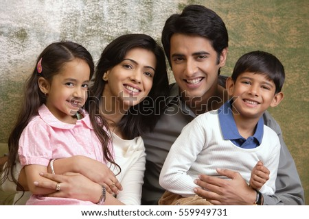 family of four smile at camera