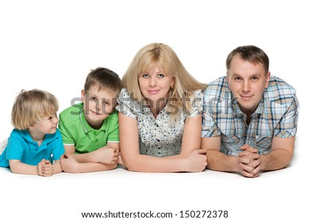 Family of four together on the white background