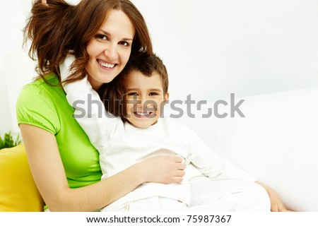 Family of happy mother and son looking at camera