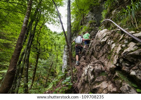 Family of hikers climbing in a canyon