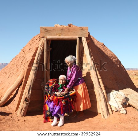 Family of 2 Navajo Women Outside Their Traditional Hogan Hut