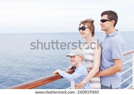 family of three enjoying vacation at cruise ship
