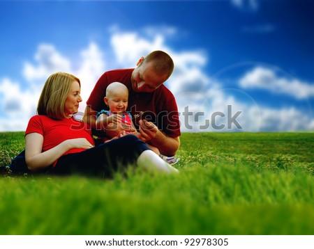 Family of three having fun in the park