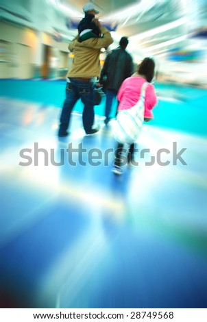 Family of travelers rushing through an airport terminal