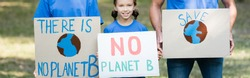 family of volunteers holding placards with globe, save, and no planet b inscription, ecology concept, banner