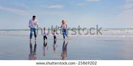 Family on a beach heaving fun.