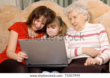 Family on a sofa with the computer