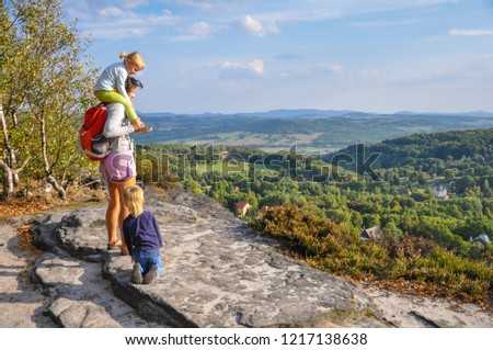 Family on a trip in the mountains, children in the mountains, trip, family trip - Decin - Switzerland National Park (Bohemian Switzerland) in Czech Republic
