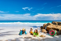 Family on beach, young couple with three year old boy. Summer vacation at Seychelles.