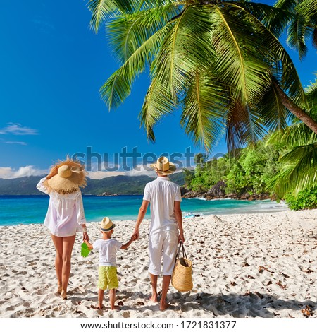 Family on beautiful Anse Soleil beach, young couple in white with three year old toddler boy. Summer vacation at Seychelles, Mahe. Photo stock ©