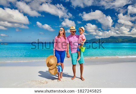 Family on beautiful Anse Soleil beach, young couple with three year old toddler boy. Summer vacation at Seychelles, Mahe. Photo stock ©