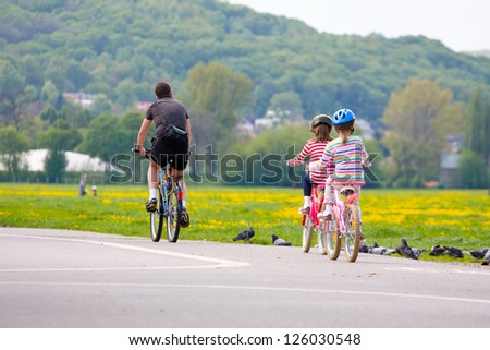 Family on bicycle ride at sunset