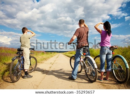 Family on bicycle ride through woodland