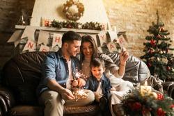 Family on Christmas with bengal lights