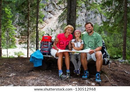 Family on hike, Family planning mountain trek - Dolomites - Italy