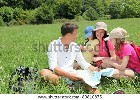 Family on hiking day looking at map
