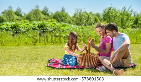 Family on picnic at sunny day