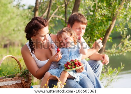 Family on picnic near the lake
