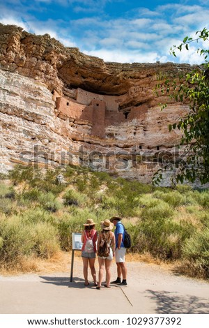 Family on sightseeing trip exploring  Montezuma Castle National Monument, dwellings located in Camp Verde, Arizona.