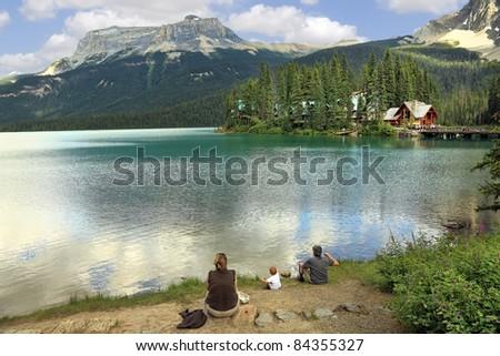 Family on the bank of Emerald lake (Yoho National park. Alberta. Canada)