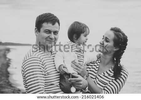 family on the beach black and white