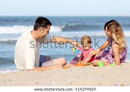 family on the sea shore