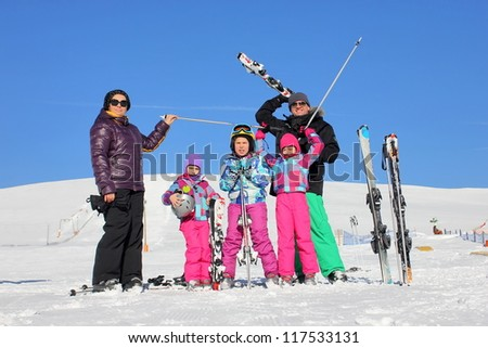 Family on the ski - stock photo