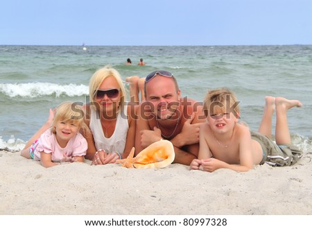 family on vacation at sea