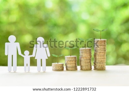 Family or child trust fund / fundraising concept : Family members, sprouts on coins on a table, depicts grantor establishes a trust fund to provide financial security to an individual e.g grandchild