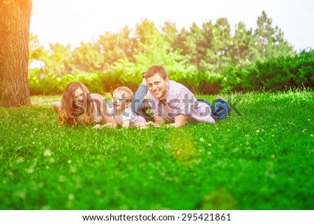 family outdoor - enjoying the summer life together - Shutterstock ID 295421861