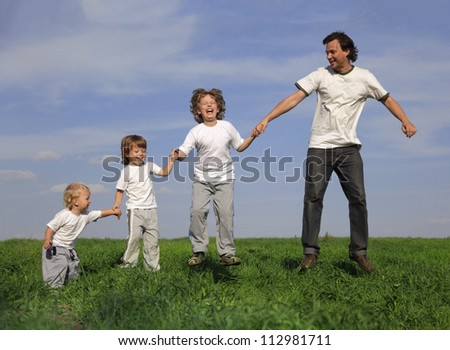 family outdoors happy jumping
