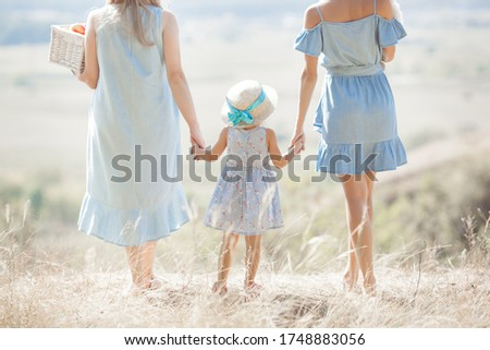 Family outdoors. Mother, Grandmother and little child together. Stockfoto ©