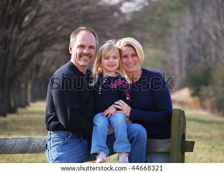 family outside at the park