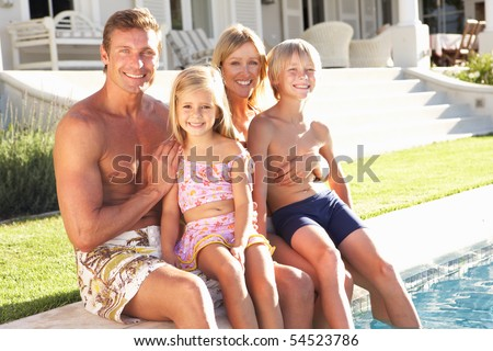 Family Outside Relaxing By Swimming Pool