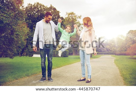 family, parenthood, adoption and people concept - happy mother, father and little girl walking in summer park and having fun
