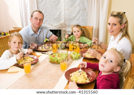 Family - parents and children - eating lunch or dinner
