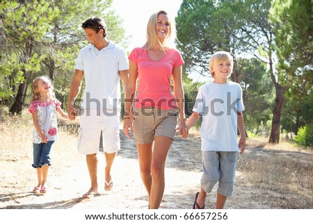 Family, parents and children,walking,walk together in park - stock photo